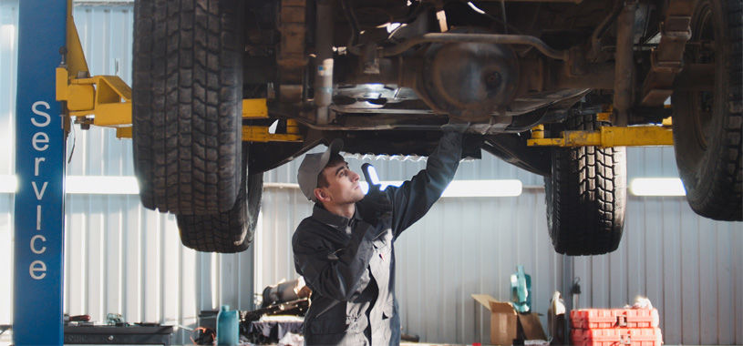 mechanic conducting car service supporting image2